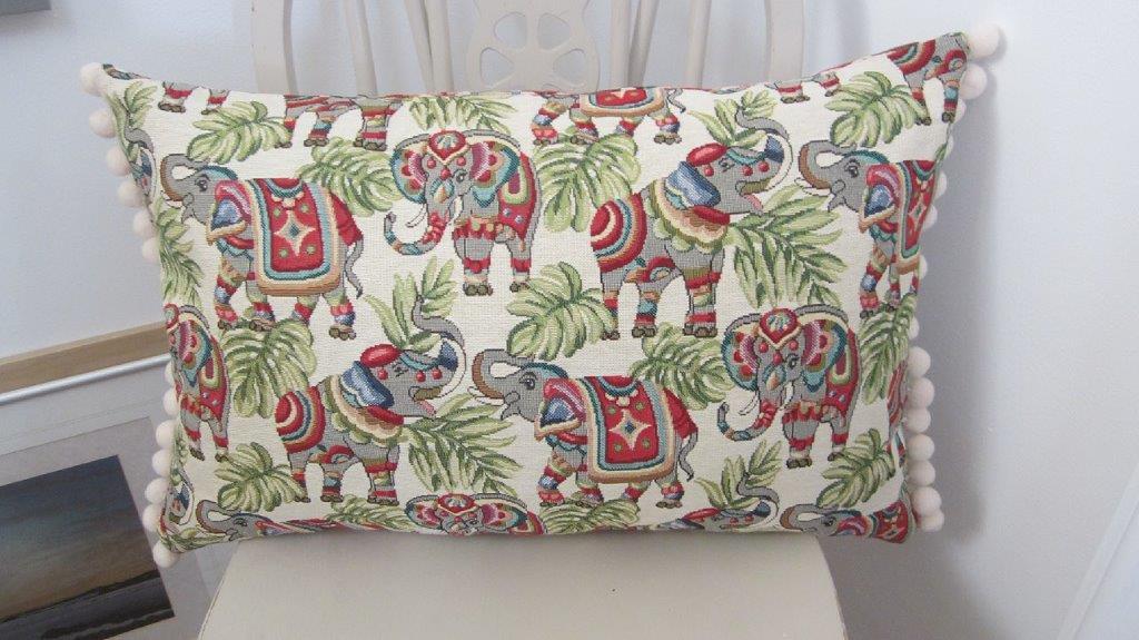 Bohemian long Elephant cushion with pom poms