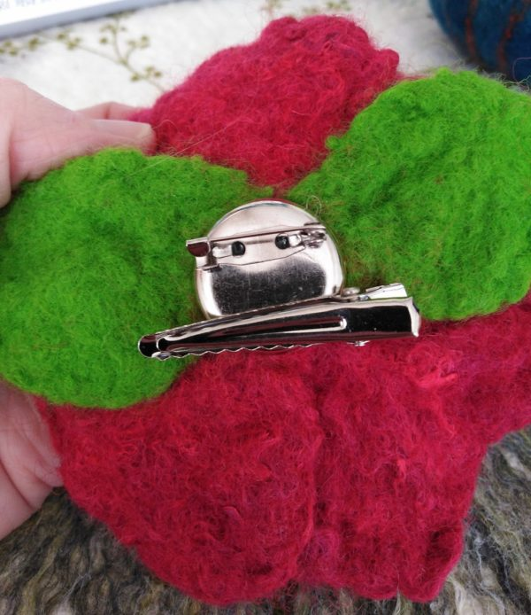 Back of a Hand Felted and Embellished Flower Corsage showing the brooch dual crocodile clip and brooch bar attachment