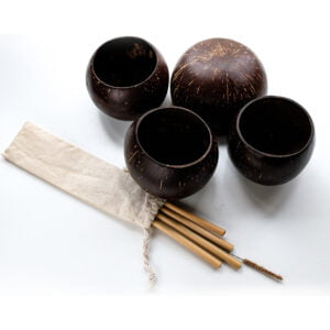 Four polished coconut cups with Bamboo straws