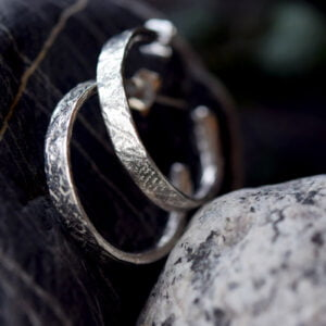 Silver hoop earrings textured